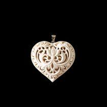 Openwork heart with flower