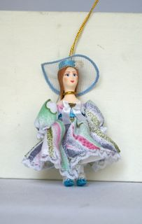Doll pendant souvenir porcelain. Girl in summer dress