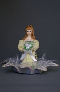 Doll gift porcelain. Thumbelina on a Lily. Fairy tale character.