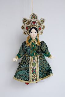 Doll pendant souvenir porcelain. Mistress of Copper Mountain. Russian traditional costume.