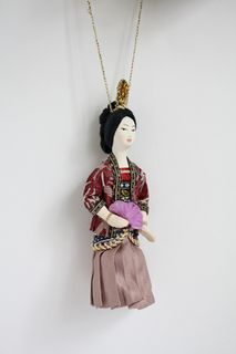 Chinese. Doll pendant