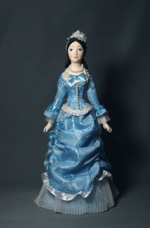 Doll gift porcelain. The lady in secular costume. The end of the 19th century. The European fashion.