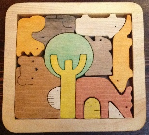 Wooden puzzle toy in the box